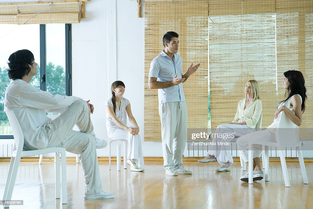 Man leading group therapy session : Stock Photo