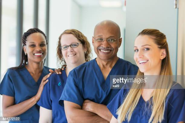 Man leading team of multi-ethnic medical professionals