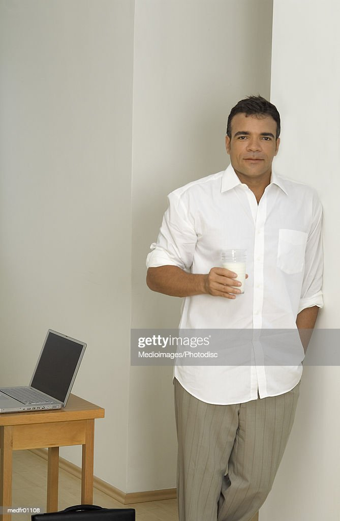Man leaning against a wall : Stock Photo