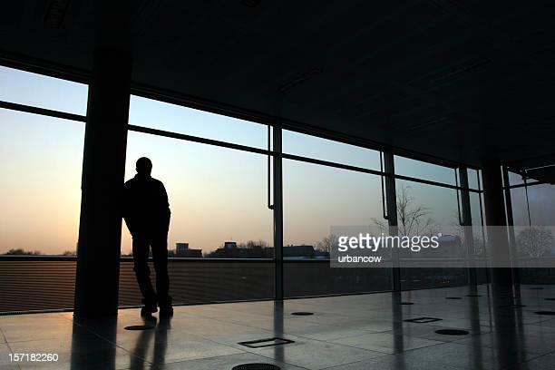 Man leaning against pillar