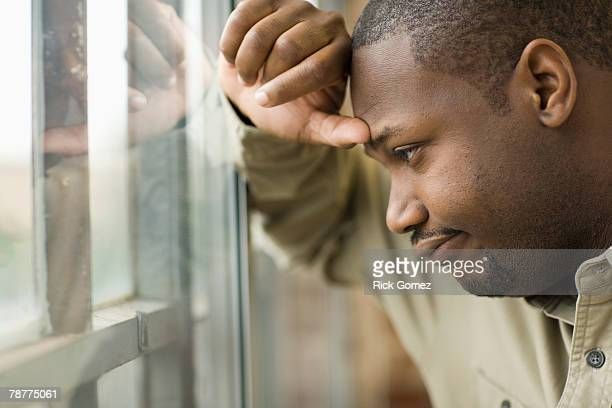 Man Leaning Against Window Pane