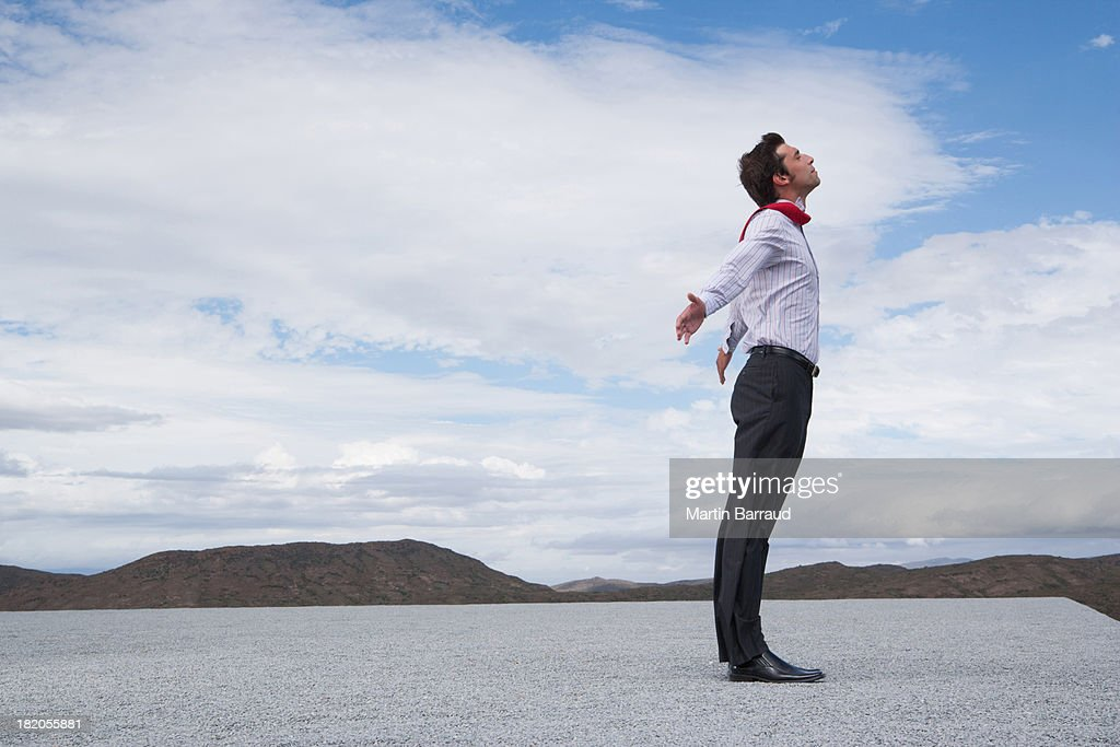 Man leaning into the wind