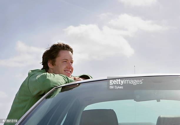 Man leaning on car