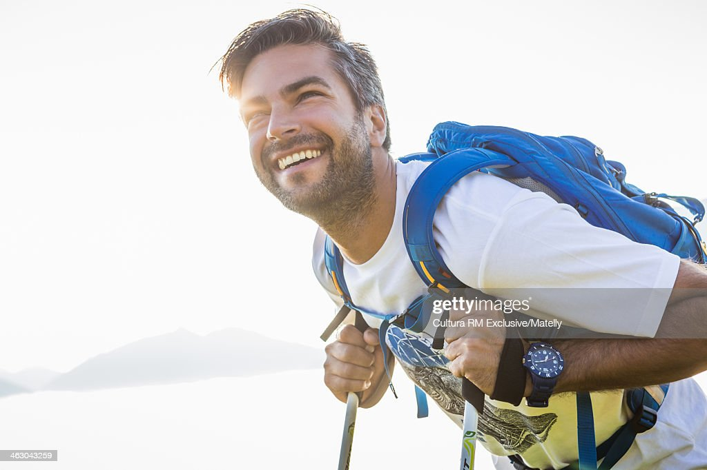 Man leaning on hiking poles smiling, Tyrol, Austria : Stock Photo