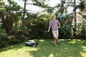 Man leaning on lawnmower