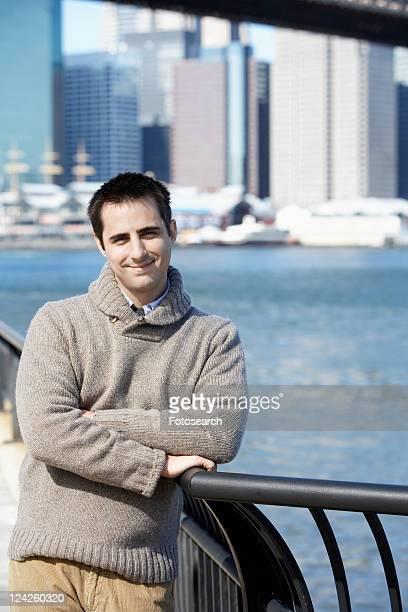 Man leaning on railing (portrait), New York City, New York, USA