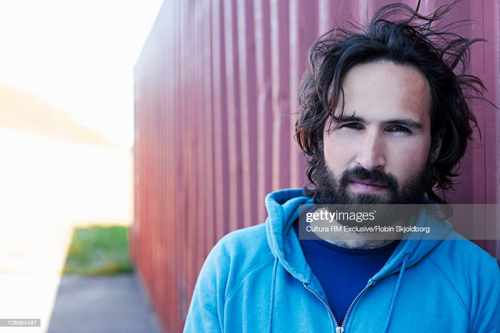 Man leaning on shipping container : Stock Photo