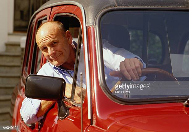 Man leaning out window of car, portrait
