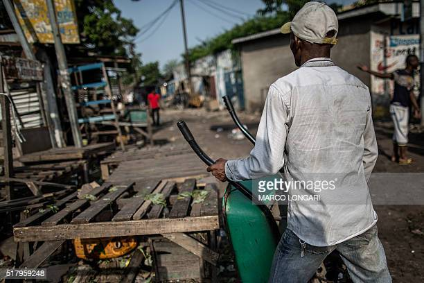 A man leans a wheelbarrow against an empty stall as a 'dead city' strike is called by five defeated opposition candidates to protest the reelection...