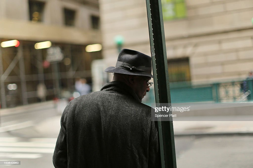 A man leans against a pole on Wall Street in Manhattan on October 9, 2012 in New York City. State Comptroller Thomas DiNapoli will release his annual report on employment and earnings October 9, in New York' City's financial industry, one of the worlds largest. While employment is still down thousands of positions since the economic crisis of 2008, DiNapoli has said that last year the sector employed 166,600 people in hedge funds, investment banks and securities trading firms.