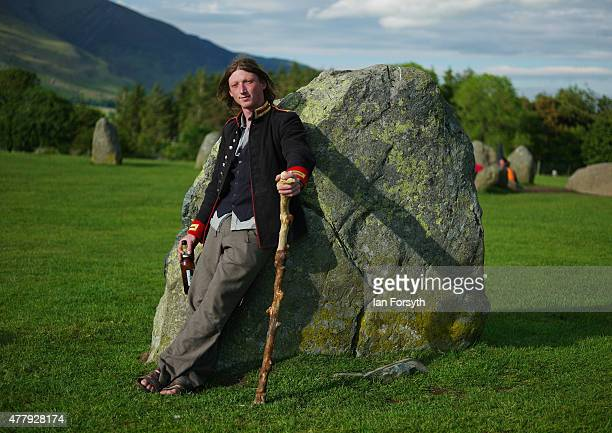 A man leans against one of the ancient stones at Castlerigg Stone Circle on the evening of the Summer Solstice on June 20 2015 in Keswick England...