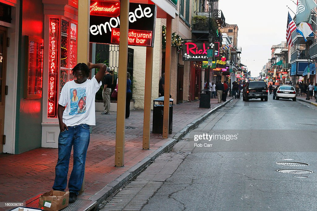 A man leans back on a pole on Bourbon Street in the French Quarter on January 28 2013 in New Orleans Louisiana