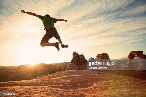 A man leaping in the air.