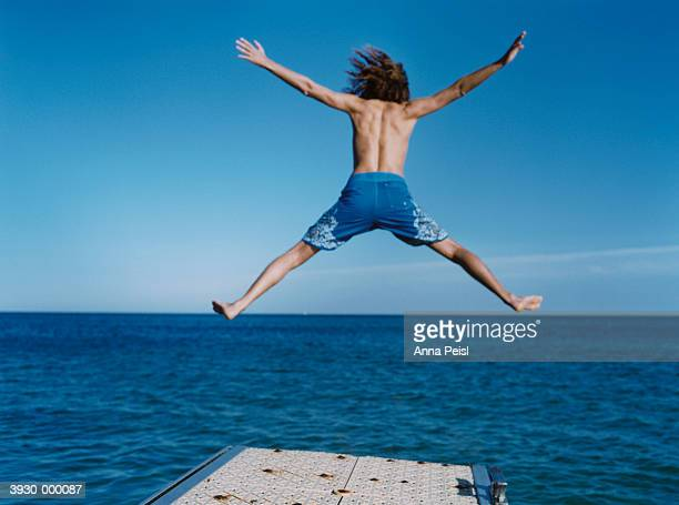 Man Leaping off Pier
