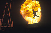 Man leaping through fireball