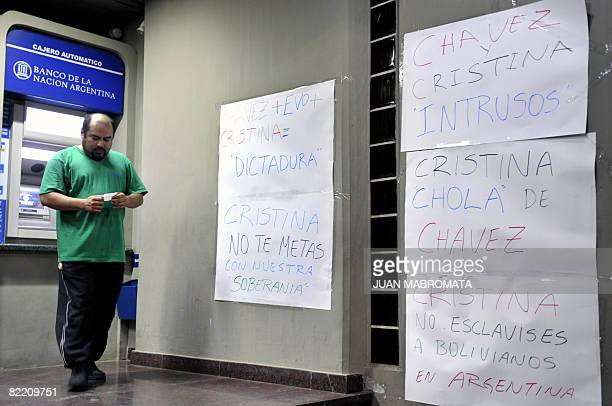 A man leaves a cash dispenser of the Banco de la Nacion Argentina in Santa Cruz Bolivia on August 7 in which opponents of President Evo Morales put...