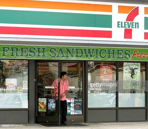 A man leaves a franchised 7Eleven store past cigarette ads posted on the door August 12 2005 in Chicago Illinois It has been reported that the Dallas...