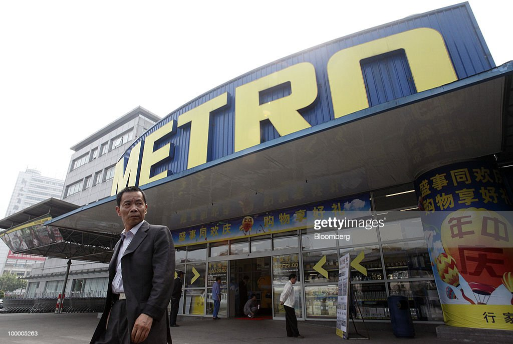 A man leaves a Metro AG supermarket in Shanghai, China, on Wednesday, May 19, 2010. Metro AG, Germany's largest retailer, plans to add 100 stores worldwide this year, the company said in a statement issued in Shanghai today. Photographer: Qilai Shen/Bloomberg via Getty Images