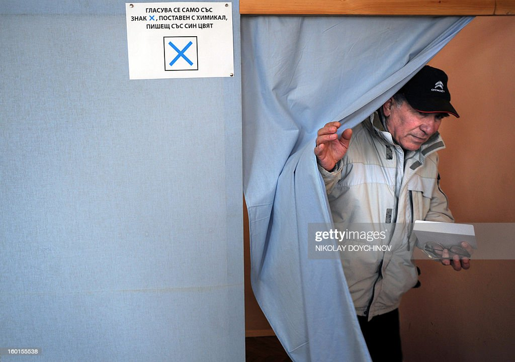 A man leaves a polling booth before voting during the national referendum in Sofia on January 27, 2013. Bulgarians voted Sunday on whether to revive plans ditched by the government to construct a second nuclear power plant, in the EU member's first referendum since communism. The referendum asks 6.9 million eligible voters: 'Should Bulgaria develop nuclear energy by constructing a new nuclear power plant?'