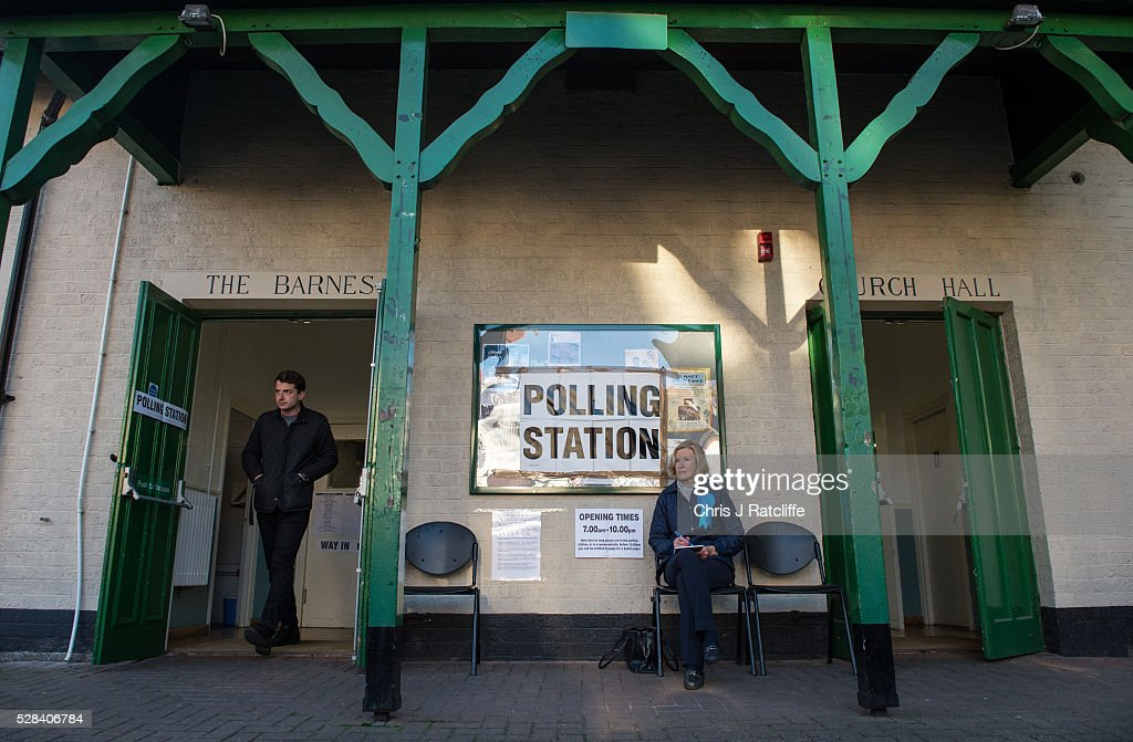 A man leaves a polling station at Kitson Hall, Barnes as a woman with a Conservative party badge sits outside before Conservative Mayoral candidate, Zac Goldsmith, arrives to cast his vote on May 5, 2016 in London, England. This is the fifth mayoral election since the position was created in 2000. Previous London Mayors are Ken Livingstone for Labour and more recently Boris Johnson for the Conservatives. The main candidates for 2016 are Sadiq Khan, Labour, Zac Goldsmith , Conservative, Sian Berry, Green, Caroline Pidgeon, Liberal Democrat, George Galloway, Respect, Peter Whittle, UKIP and Sophie Walker, Woman's Equality Party. Results will be declared on Friday 6th May.