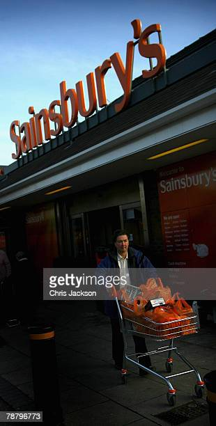 A man leaves a Sainsburys store in Wandsworth on January 7 2008 in London England Shops are preparing to announce their results after the Christmas...