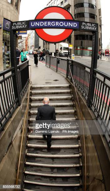A man leaves a subway at Monument Underground station in central London as a 48 hour strike by the RMT union causes widespread disruption to the...