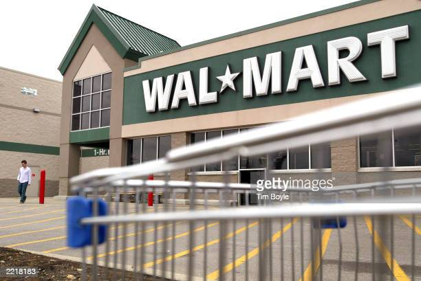 A man leaves a WalMart store July 28 2003 in Rolling Meadows Illinois WalMart said that sales in the month of July at its US stores that were open at...