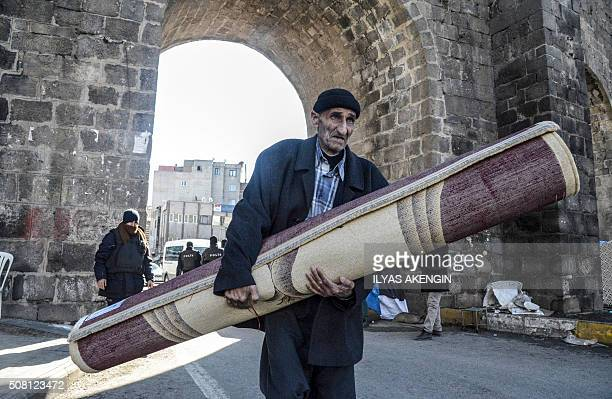 TOPSHOT A man leaves his house during a curfew in the Sur district of Diyarbakir on February 3 2016 Vowing to flush out the Kurdistan Worker's Party...