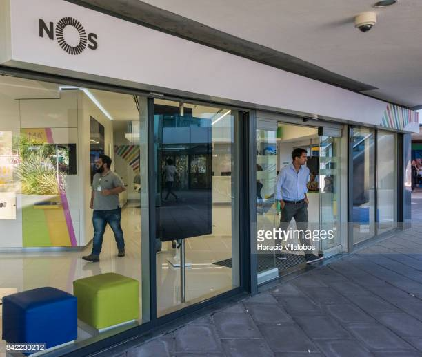 A man leaves the public's attention area at the headquarters of Portuguese 'NOS Comunicacoes' a GSM/UMTS/LTE mobile operator on August 30 2017 in...