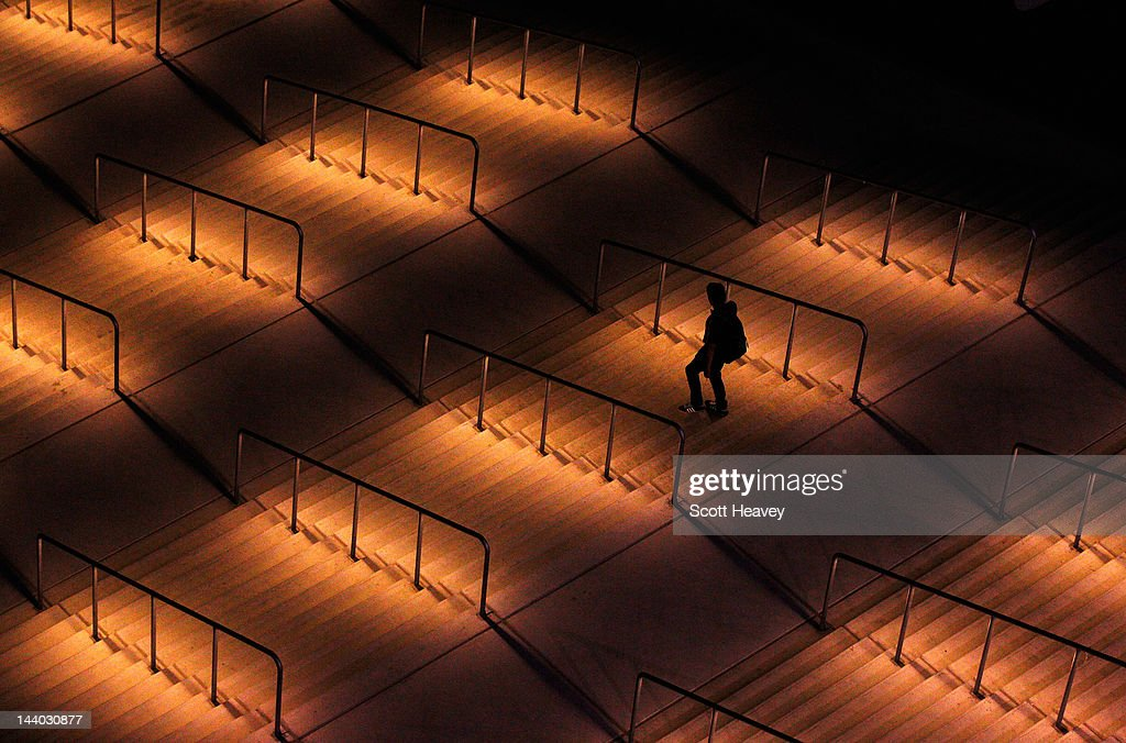 A man leaves the stadium during the Athletic Bilbao training session ahead of the UEFA Europa League Final between Atletico Madrid and Athletic Bilbao at the National Arena on May 8, 2012 in Bucharest, Romania.