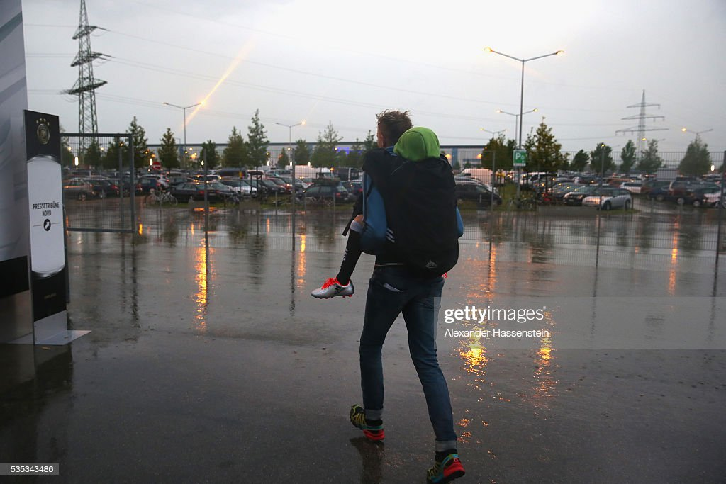 A man leaves the stadium with his child on the shoulder during the international friendly match between Germany and Slovakia at WWK-Arena on May 29, 2016 in Augsburg, Germany.