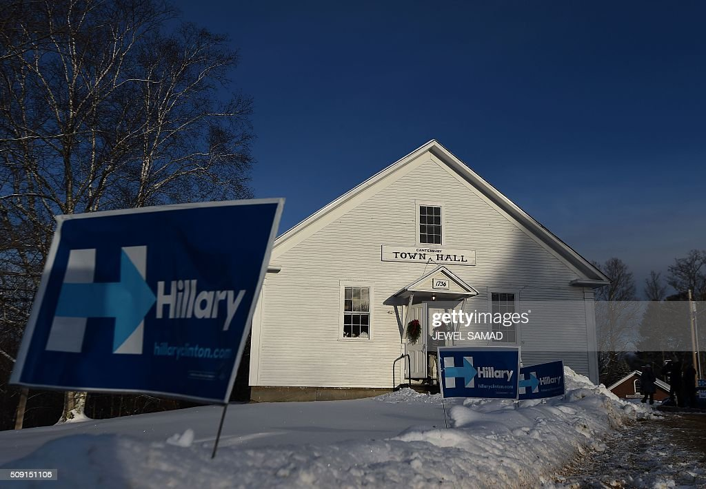 A man leaves the town hall after voting for the first US presidential primary at the town hall in Canterbury, New Hampshire, on February 9, 2016. New Hampshire began voting on February 9 in the first US presidential primary with Republican Donald Trump calling on supporters to propel him to victory and Democrat Bernie Sanders primed to upstage Hillary Clinton. The northeastern state, home to just 1.3 million people, sets the tone for the primaries and could shake out a crowded Republican field of candidates pitting Trump and arch-conservative Senator Ted Cruz against more establishment candidates led by Senator Marco Rubio. / AFP / Jewel Samad