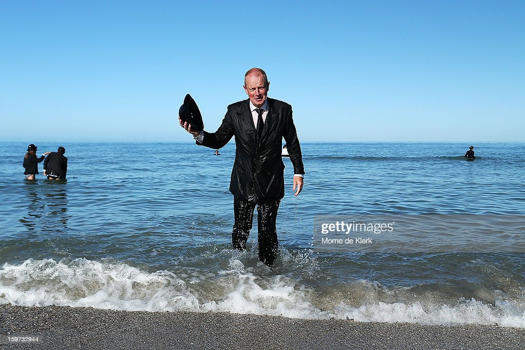A man leaves the water after taking part in an art installation created by surrealist artist Andrew Baines on January 20, 2013 in Adelaide, Australia.