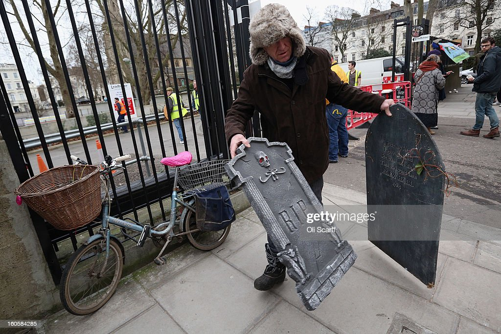 A man leaves with props previously used in 'The London Dungeon' which he bought at a car boot sale in Pimlico as the attraction prepares to move to new premises on the Southbank, on February 3, 2013 in London, England. The sale features a selection of torture and surgical implements, costumes, plague doctor's potions, false eyeballs, severed limbs, and a set of stocks. The London Dungeon will reopen in March 2013 in larger premises on the Thames' Southbank, having moved from Tooley Street where it originally opened 38 years ago.