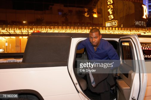 Man leaving limousine in front of casino, portrait : Bildbanksbilder