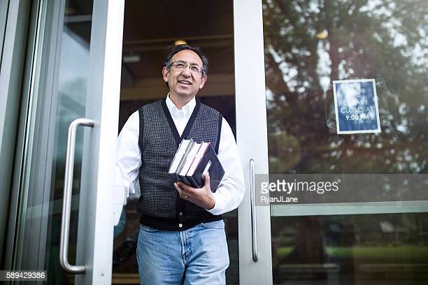 Man Leaving Public Library with Books