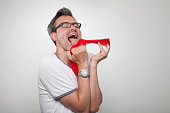 fetishist holds a red nylon stocking with his fingers licking it enjoyable