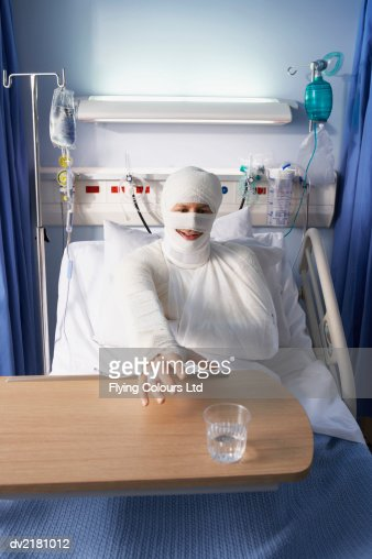 Man In Bandages On Hospital Bed