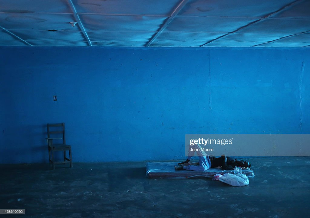 A man lies in a newly-opened Ebola isolation center set up by the Liberian health ministry in a closed school on August 14, 2014 in Monrovia, Liberia. People suspected of contracting the Ebola virus are being sent to such centers in the capital Monrovia where the spread of the highly contagious and deadly Ebola virus has been called catastrophic. The epidemic has killed more than 1,000 people in four West African countries.