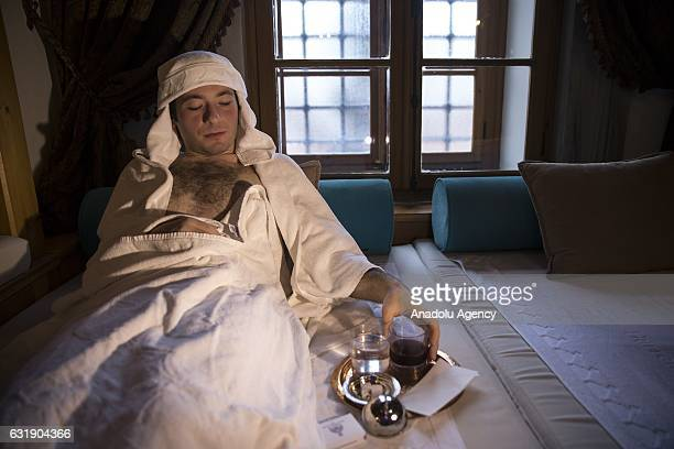 A man lies in a room after having bath in the Haseki Hurrem Sultan Hamam Istanbul Turkey on January 17 2017 The Haseki Hurrem Sultan Hamam which is...