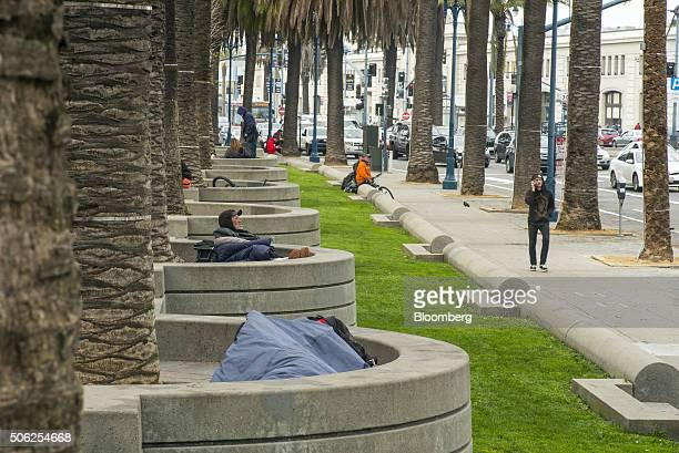 A man lies in a sleeping bag in Justin Herman Plaza in San Francisco California US on Thursday Jan 21 2016 San Francisco host city for the National...