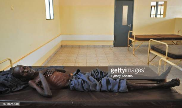 A man lies sick in the ward for Tuburculosis and HIV patients in the Juba Hospital in South Sudan February 8 2008 Since the numbers of Sudanese...