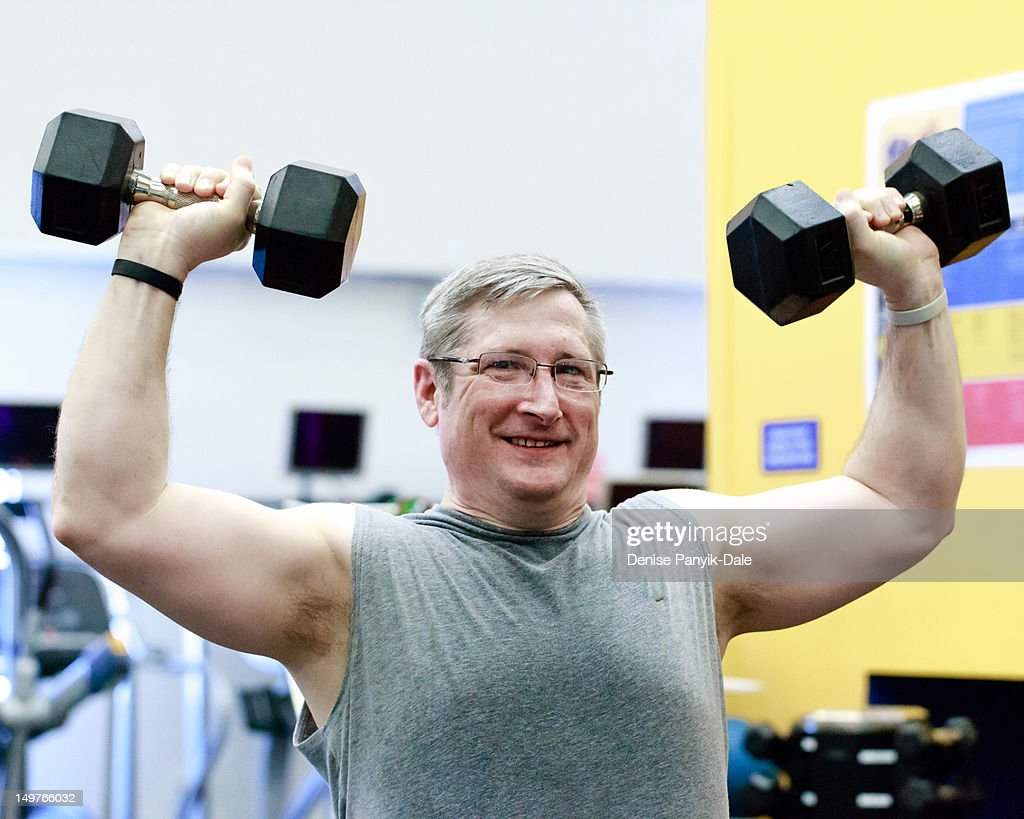 Man lifting dumbbells : Stock Photo