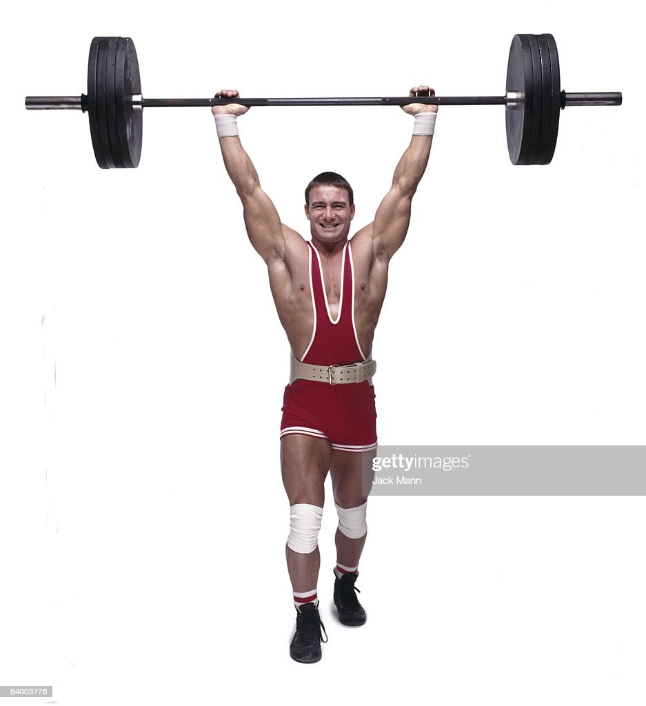 Man Lifting Weight Stock Photo | Getty Images