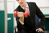 Man Lifting Weights in Office