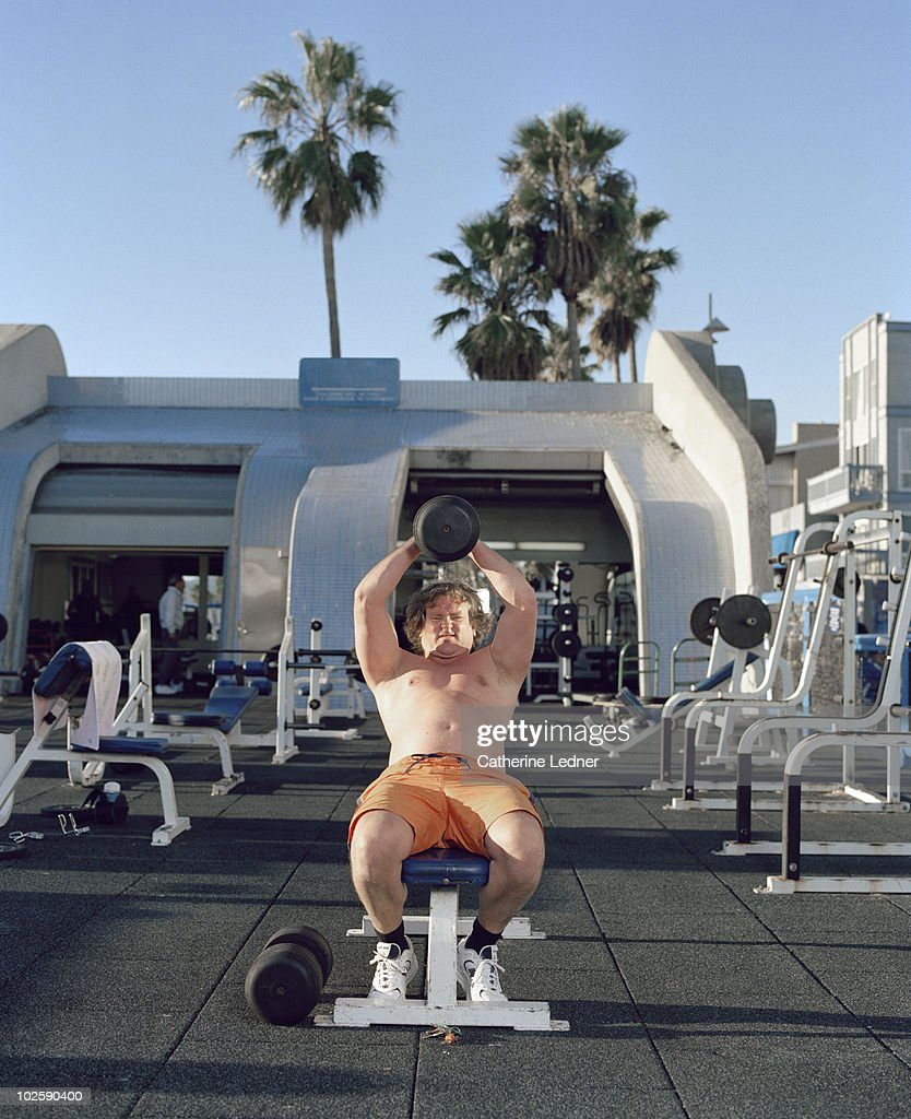 Man Lifting Weights in Venice Beach, CA : Stock Photo