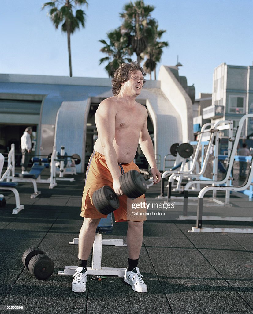 Man Lifting Weights in Venice, CA : Stock Photo