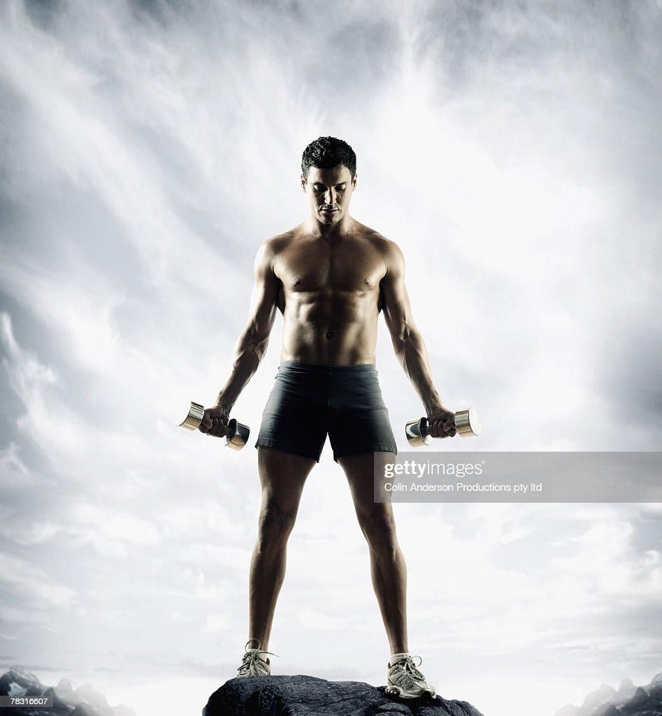 Man lifting weights : Stock Photo