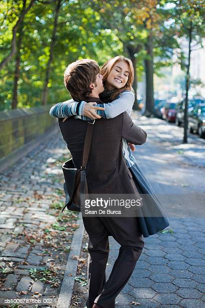 Man lifting woman, smiling
