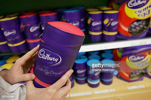 A man lifts a Cadbury Chocolate easter egg from the shelf at Cadbury World visitor centre on February 25 2005 in Birmingham England The company is...